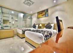 Hotel King's Heritage - Surat - Schlafzimmer