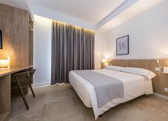 Hotel Victori - 埃斯卡斯特利 - 臥室