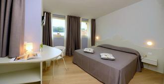 Aromi Piccolo Hotel - Saló - Habitación