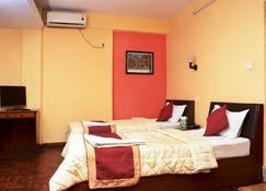 Kathmandu Eco Hotel - Katmandu - Quarto