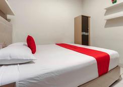 卡雷特塞蒂亞布迪瑞德多茲酒店 - 雅加達 - 南雅加達 - 臥室