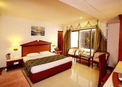 Westway Hotel - Kozhikode - Bedroom
