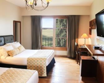 Wyndham Garden Lujan - Luján - Спальня