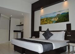 エグゼクティブ ホテル - マニラ - 寝室