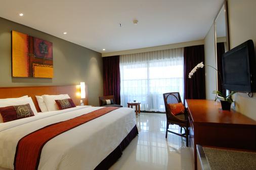 峇里王朝假日酒店 - 庫塔 - 庫塔 - 臥室