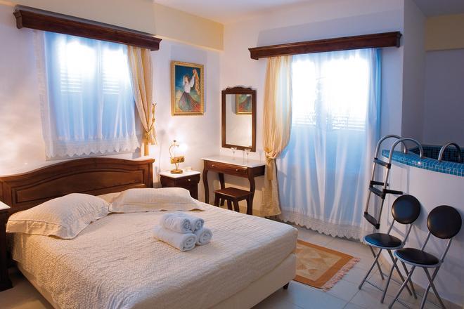 艾里諾恩西婭精品酒店 - 聖托里尼 - 菲羅斯特法尼 - 臥室
