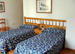 هوتل يوكانكا - San Isidro - غرفة نوم