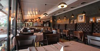 Atlas Posthotel - גרמיש-פרטנקירכן - מסעדה