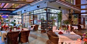 Green Garden Suites Hotel - אלניה - מסעדה