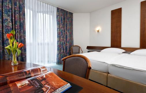 Days Inn by Wyndham Leipzig Messe - Leipzig - Phòng ngủ