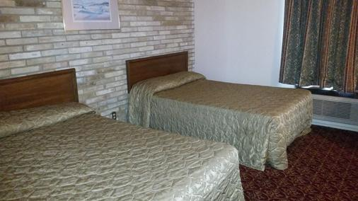 Executive Inn and Suites Waxahachie - Waxahachie - Schlafzimmer