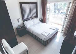 Royal Suites Hotel Apartments - Bengaluru - Schlafzimmer