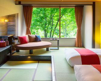 Hoshino Resorts Oirase Keiryu Hotel - Towada - Bedroom