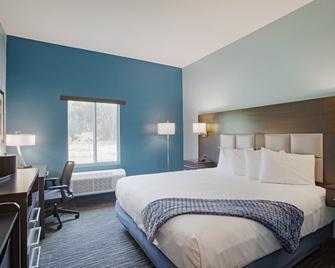 Iris Garden Inn - Garden City - Schlafzimmer