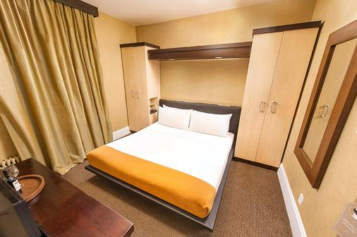 Amsterdam Court Hotel - New York - Phòng ngủ