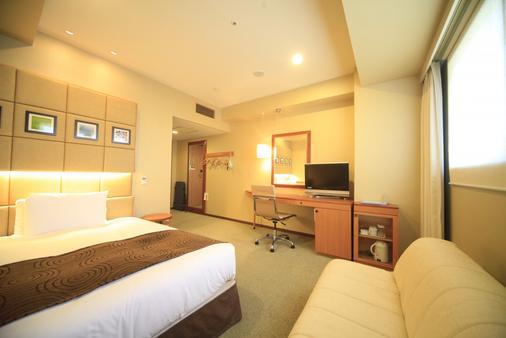 호텔 선루트 히가시 신주쿠 - 도쿄 - 침실