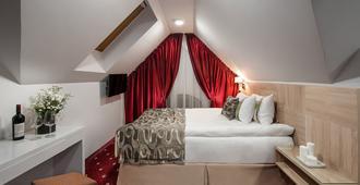 Thomas Albert Hotel - Chişinău - Schlafzimmer
