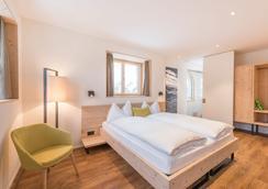 藍多林思家庭度假酒店 - 聖莫里茨 - 臥室