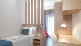Alunni Stacc Guesthouse - Lisbona - Camera da letto