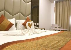 Aavaa Surya Continental Hotel - New Delhi - Bedroom
