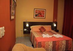 La Posada De Lobo Hotel & Suites - Iquitos - Κρεβατοκάμαρα
