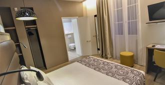 Hôtel Montaigne Sarlat la Caneda - Sarlat-la-Canéda - Phòng ngủ