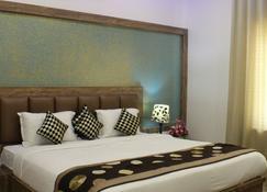 Regal Hotel and Restaurant - Матхура - Спальня