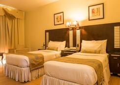 The Red Maple Mashal - Indore - Schlafzimmer