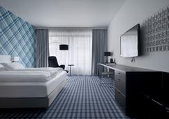 Premier Suites Plus Antwerp - Amberes - Habitación