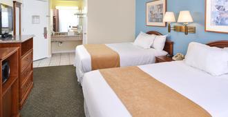 Edgewater Inn And Suites - פיסמו ביץ' - חדר שינה