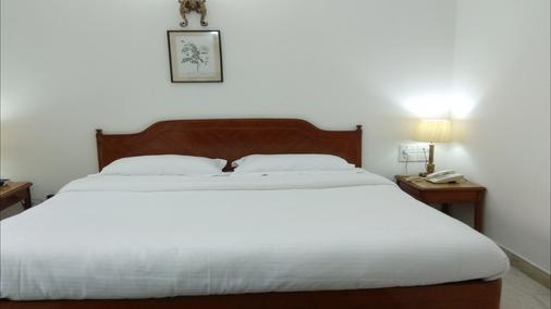 棕櫚格林酒店 - 新德里 - 臥室