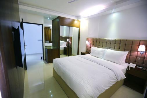Blossom Hotel - Dhaka - Bedroom