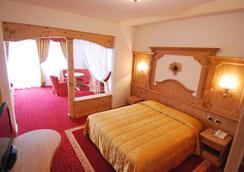 Hotel Belvedere & Paradise Club Center - Fai della paganella - Makuuhuone
