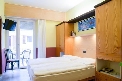 Ambienthotel Luna Rossa - Malcesine - Κρεβατοκάμαρα