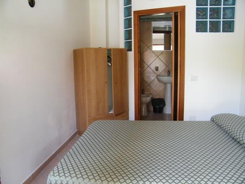 Hotel Villaggio Tabù - Centola - Schlafzimmer