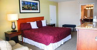 R Nite Star Inn and Suite - Arlington - Bedroom