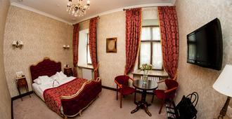 Saint Feder Hotel - Lviv - Slaapkamer