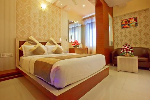 Aishwarya Suites - Mysore - Phòng ngủ