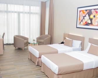 Fly Hotel - Libreville - Schlafzimmer
