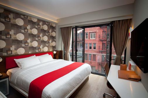 NobleDEN Hotel - New York - Schlafzimmer