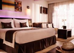 PALM Hotel & Spa - Petite-Île - Habitació