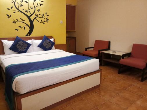 Telehaus International Hotel - Bengaluru - Bedroom