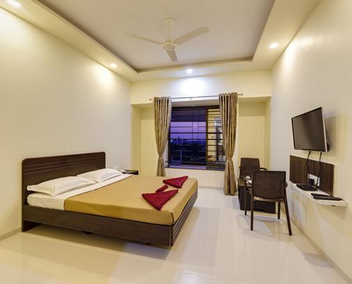 Galaxy Inn - Kolhāpur - Bedroom