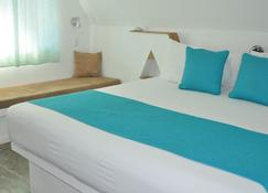 Punta Rucia lodge by Mint - Villa Isabela - Bedroom