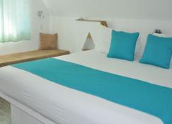 Punta Rucia lodge by Mint - Villa Isabela - Bedroom