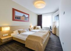 Ahotel Ljubljana - Lubiana - Camera da letto