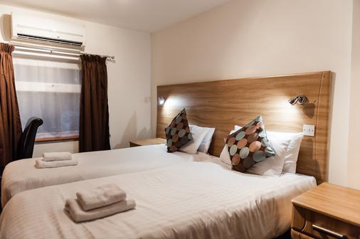 OYO Arinza Hotel - Ilford - Κρεβατοκάμαρα