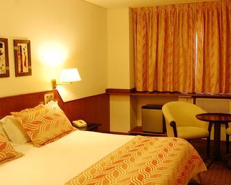 Quintana San Luis Hotel - San Luis - Schlafzimmer