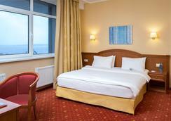Cosmos Petrozavodsk Hotel - Petrozavodsk - Bedroom