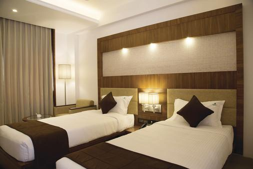 Urvashi Residency - Chennai - Phòng ngủ